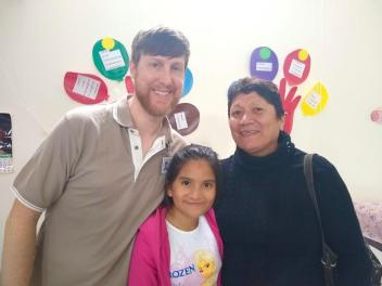 Dana with patients, smiling